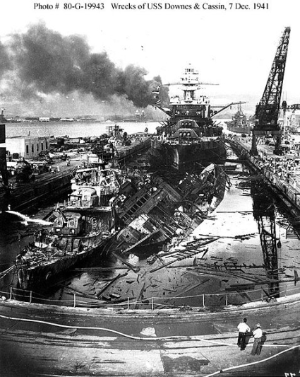 USS Pennsylvania, behind the wreckage of the USS Downes and USS Cassin.