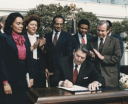 President Ronald Reagan signs Martin Luther King Holiday Bill.